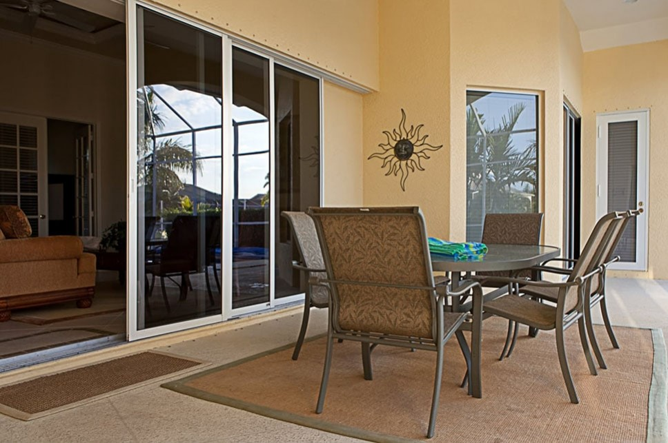 Sliding patio doors leading to an outdoor dining area